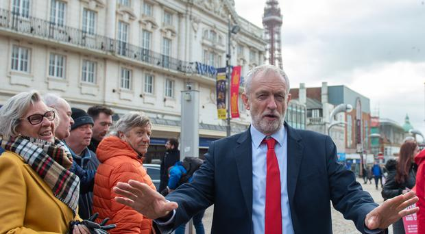 Labour Party leader Jeremy Corbyn speaks to the media on the seafront in Blackpool (Joe Giddens/PA)