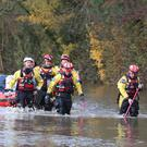 Rescuers pull a boat through floodwater in Fishlake, Doncaster (Danny Lawson/PA)
