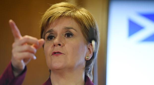 Nicola Sturgeon hopes the SNP hold the balance of power after the election (Daniel Leal-Olivas/PA)