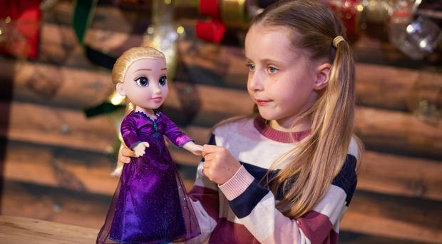 Gwen Macdonald, eight, plays with a Frozen 2 Into the Unknown Elsa Doll (Aaron Chown/PA)