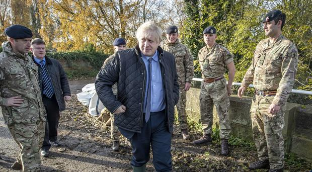 Boris Johnson with members of the Light Dragoons during a visit to Stainforth, Doncaster (Danny Lawson/PA)