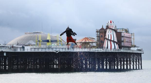 Richard Browning in his body-controlled, jet engine-powered suit near Brighton Pier (Gareth Fuller/PA)