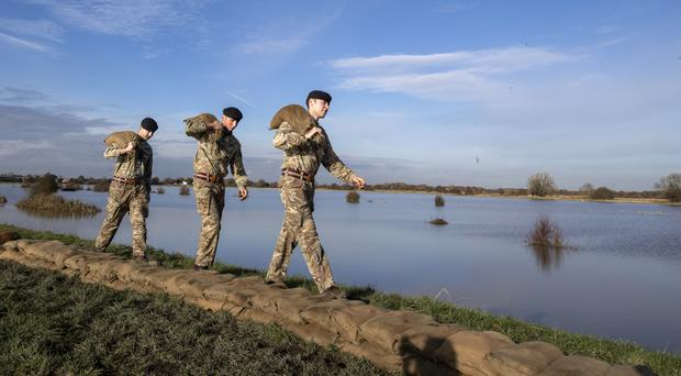 Soldiers carry sandbags along an embankment at Stainforth, near Doncaster (PA)