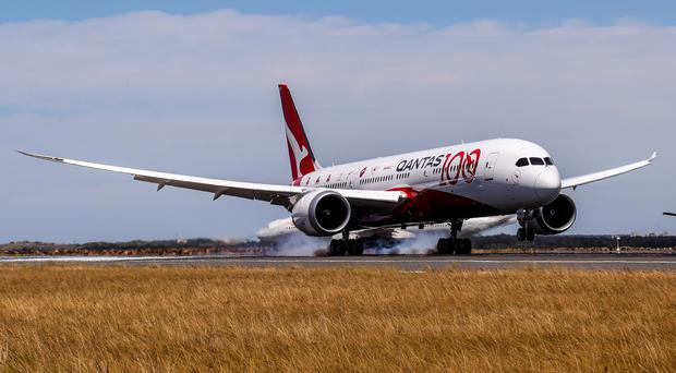 The Qantas Dreamliner touches down in Sydney at the end of its marathon non-stop trip from London (Qantas/PA)
