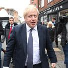 Boris Johnson has dismissed claims that the Tories offered peerages to senior Brexit Party figures to stand aside in the General Election (Stefan Rousseau/PA)
