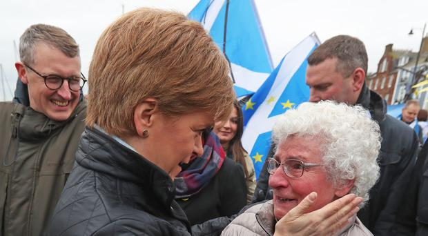 Scottish First Minister Nicola Sturgeon meets voters and activists in Abroath (Andrew Milligan/PA)