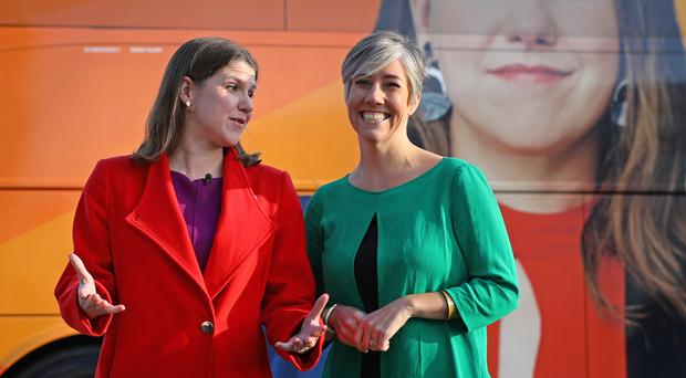 Jo Swinson, left, with Lib Dem candidate for St Albans Daisy Cooper during a visit to Imagination Technologies in St Albans (Aaron Chown/PA)