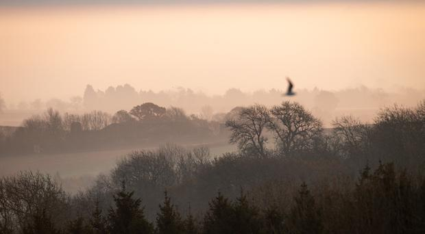 A cold and foggy morning over Burton Dassett Hills Country Park in Warwickshire (Jacob King/PA)