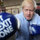 Prime Minister Boris Johnson during a visit to Jimmy Egan's Boxing Academy at Wythenshawe, while on the campaign trail ahead of the General Election (Stefan Rousseau/PA)