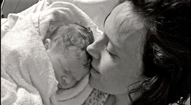 Rhiannon Davies with her daughter Kate Stanton Davies who died shortly after birth in 2009 (Richard Stanton/PA)
