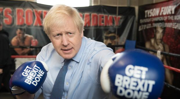 Boris Johnson during a campaign visit to Jimmy Egan's Boxing Academy in Wythenshawe, Manchester (Stefan Rousseau/PA)