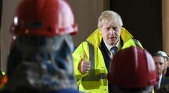 Boris Johnson speaks to staff at Wilton Engineering Services in Middlesbrough (Stefan Rousseau/PA)