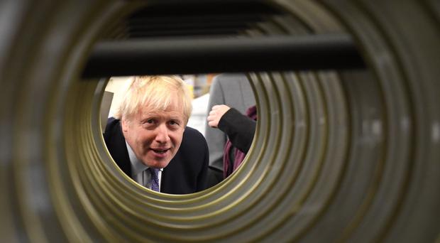 Boris Johnson visits washing machine manufacturer Ebac in Newton Aycliffe while campaigning in the Sedgefield constituency (Stefan Rousseau/PA)