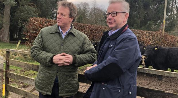 Alister Jack (left) and Michael Gove (Katrine Bussey/PA)
