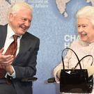Sir David Attenborough with the Queen (Eddie Mulholland/The Daily Telegraph/PA)