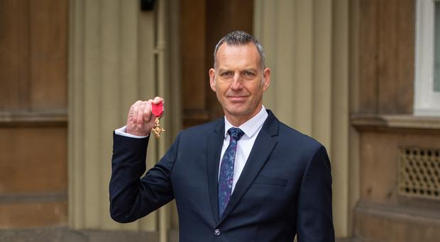 Detective Superintendent Mark Gower with his OBE (Dominic Lipinski/PA)