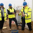 Boris Johnson visits a building site for new houses in Bedford while on the campaign trail (Stefan Rousseau/PA)