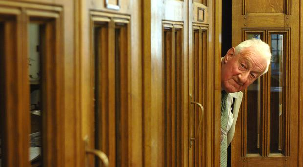 PA political correspondent Chris Moncrieff in one of the old telephone booths in the Press Gallery in the Houses of Parliament (Clara Molden/PA)