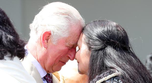 The Prince of Wales receives a Hongi, a traditional Maori greeting during his visit to Tuahiwi Marae, a tribal meeting ground on the South Island of New Zealand (Chris Jackson/PA)