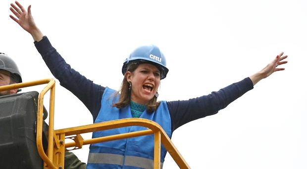 Liberal Democrat leader Jo Swinson on a cherry picker during a visit to an eco home-building site in Sheffield (Aaron Chown/PA)