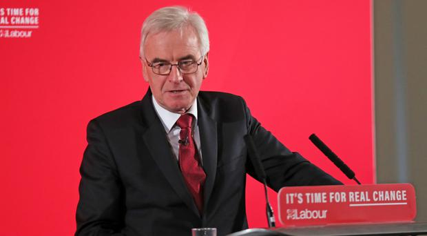 Shadow chancellor John McDonnell says Labour will compensate women who lost out following pension changes (Steve Parsons/PA)