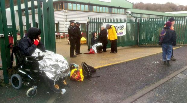 Protesters chained themselves to the gates of the factory (Brighton Against The Arms Trade/Shut Down The Arms Trade/PA)