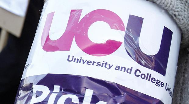 University workers are striking in disputes over pay and pensions (Peter Byrne/PA)