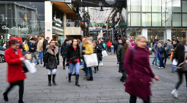 Shoppers outside Bristol's Cabot Circus shopping mall. New figures from the CBI show that retail sales are close to returning to growth after an improvement in November (Ben Birchall/PA)
