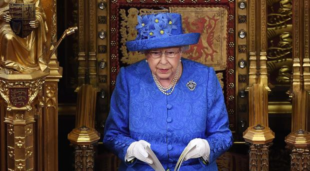The Queen reading the Queen's Speech at a reduced ceremonial state opening in 2017 (Carl Court/PA)