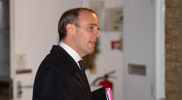 Foreign Secretary Dominic Raab arrives for a hustings event at East Molesey Methodist Church in Surrey (Dominic Lipinski/PA)