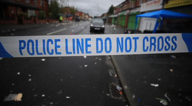 Police tape (Peter Byrne/PA)