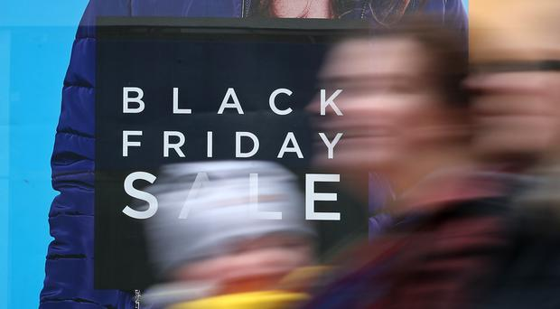 "Shops in Canterbury, Kent, display offer posters ahead of Black Friday sales. Just one in 20 so-called Black Friday ""deals"" are cheaper during the shopping bonanza than at other times of the year, Which? said."