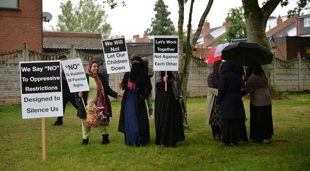 Protesters outside Anderton Park Primary School (Jacob King/PA)