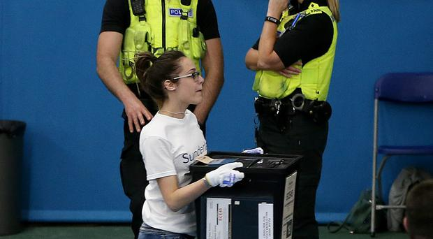 Running ballot boxes into the sports hall at Silksworth, Sunderland, has been a TV tradition in recent elections (Nigel Roddis/PA)
