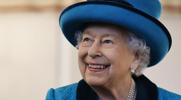 The Queen visits the headquarters of the Royal Philatelic Society in London (Tolga Akmen/PA)
