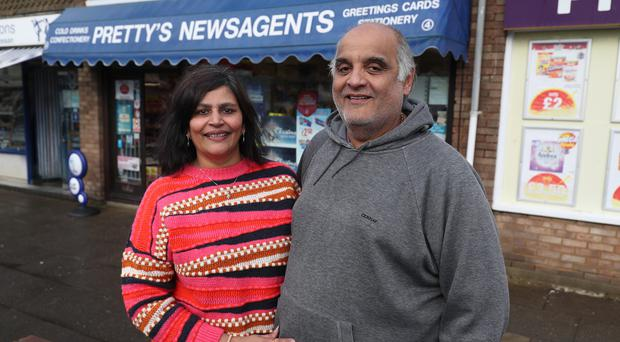 Priti Patel and her husband Kandarp, who run the shop where Steve Thomson purchased his winning Euro Millions lottery ticket (Andrew Matthews/PA)