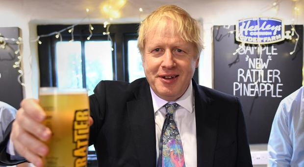 Boris Johnson visits the Healey's Cornish Cyder Farm, near Truro in Cornwall (Stefan Rousseau/PA)