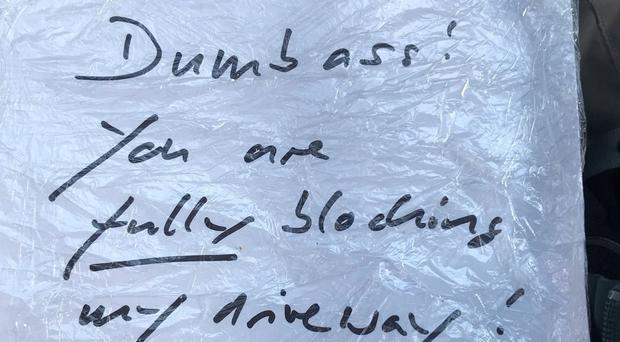 Note left on ambulance attending medical emergency in Lymington, Hampshire. Photo credit: SCAS/PA Wire