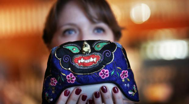 Francesca Baseby holding embroidery from an archive of needlework, which was recently discovered in a cupboard after 50 years (David Cheskin/Edinburgh University/PA)