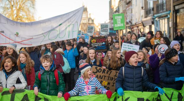 Children take part in a YouthStrike4Climate march in Cambridge (Joe Giddens/PA)