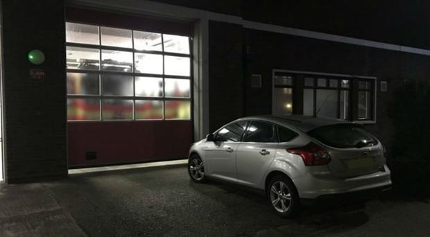 The car was parked outside the door to the fire station (Hampshire Fire and Rescue/PA)