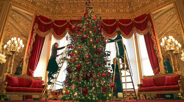 A 15ft Christmas tree in the Crimson Drawing Room at Windsor Castle (Steve Parsons/PA)