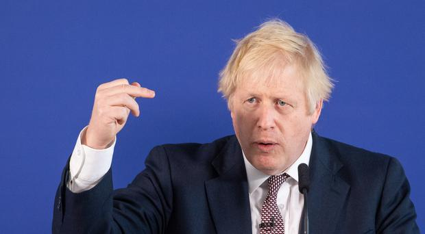 Boris Johnson speaking at a press conference while on the General Election campaign trail (Dominic Lipinski/PA)