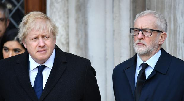 Prime Minister Boris Johnson (left) and Labour leader Jeremy Corbyn take part in a vigil in Guildhall Yard, London, to honour the victims off the London Bridge terror attack (Dominic Lipinski/PA)