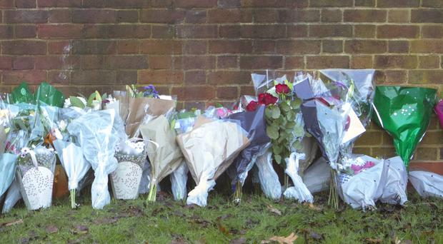 Flowers and tributes at the scene near Debden Park High School, in Loughton, Essex, as a murder investigation has been launched after a 12-year-old boy was killed when a car crashed into children.