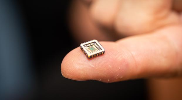 One of the artificial neurons in its protective casing on a fingertip (University of Bath/PA)