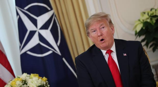 Donald Trump was engaged in a diplomatic flare-up with Emmanuel Macron over Nato (Jonathan Brady/PA)