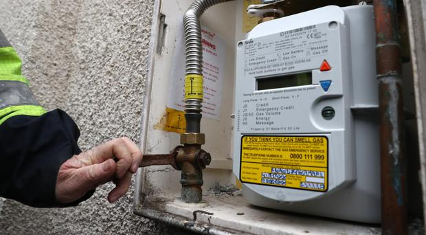 SGN first call operative Martin Beer checks gas pressure on a meter at a house in Stenhousemuir (Andrew Milligan/PA)