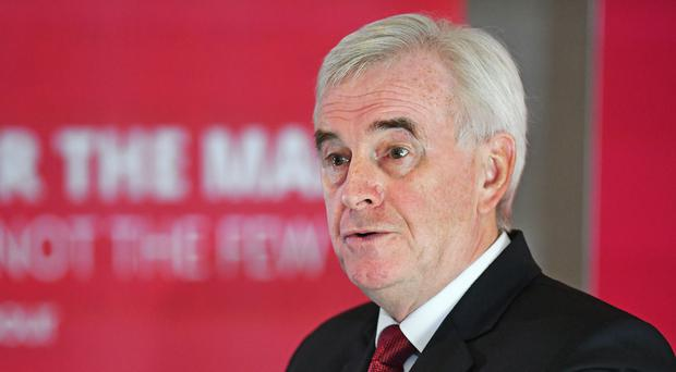 Shadow chancellor John McDonnell delivers a speech during a campaign event in Birmingham (Jacob King/PA)