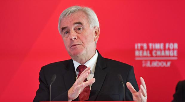 Shadow chancellor John McDonnell delivers a speech on the economy at a campaign event in Birmingham (Jacob King/PA)